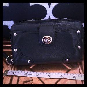 Black Coach Wristlet wallet. Fits iPhone 7 no case
